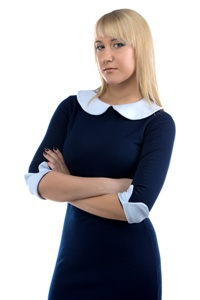 Businesswoman in dress with arms crossed